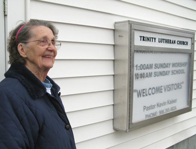 Betty in front of her church, Iron River, 2010.